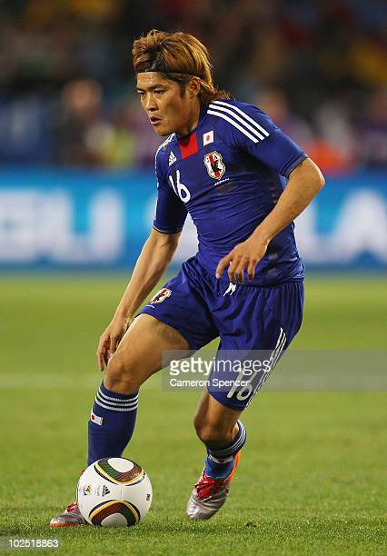 Yoshito Okubo of Japan runs with the ball during the 2010 FIFA World Cup South Africa Round of Sixteen match between Paraguay and Japan at Loftus...