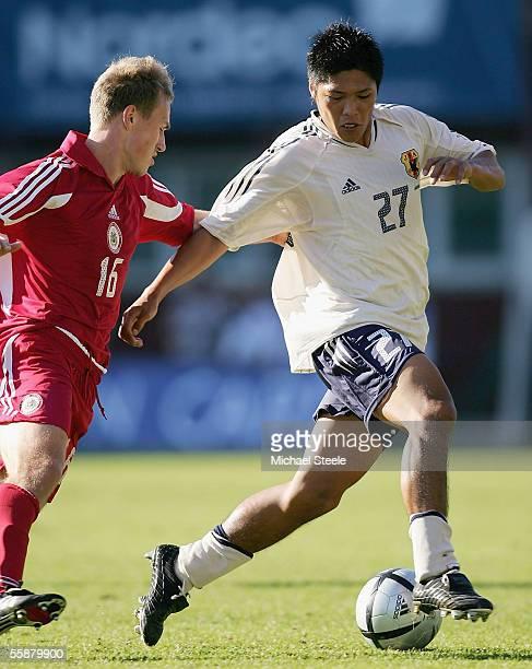 Yoshito Okubo of Japan shadowed by Aleksejs Visnakovs of Latvia during the Friendly International match between Latvia and Japan at the Skonto...