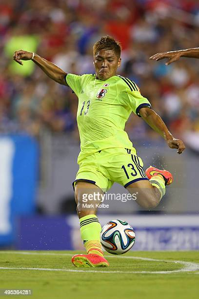 Yoshito Okubo of Japan shoots at goal during the International Friendly Match between Japan and Costa Rica at Raymond James Stadium on June 2 2014 in...