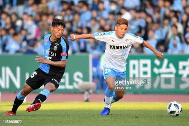 Yoshito Okubo of Jubilo Iwata and Hidemasa Morita of Kawasaki Frontale compete for the ball during the JLeague J1 match between Kawasaki Frontale and...