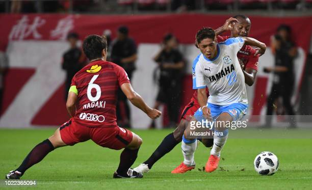 Yoshito Okubo of Jubilo Iwata and Leo Silva of Kashima Antlers compete for the ball during the JLeague J1 match between Kashima Antlers and Jubilo...