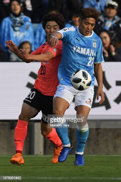 Yoshito Okubo of Jubilo Iwata and Shion Inoue of Tokyo Verdy compete for the ball during the JLeague J1/J2 playoff final between Jubilo Iwata and...