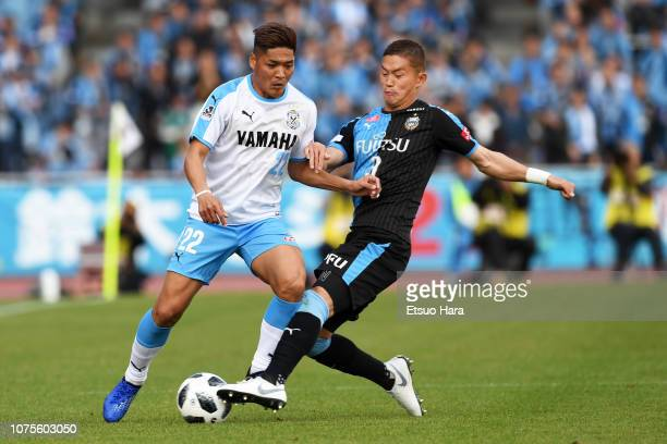 Yoshito Okubo of Jubilo Iwata and Tatsuki Nara of Kawasaki Frontale compete for the ball during the JLeague J1 match between Kawasaki Frontale and...