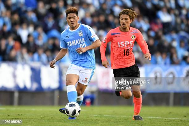 Yoshito Okubo of Jubilo Iwata and Yuhei Sato of Tokyo Verdy compete for the ball during the JLeague J1/J2 playoff final between Jubilo Iwata and...