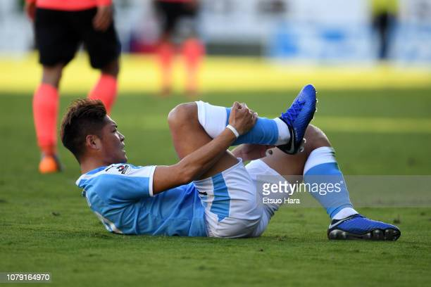 Yoshito Okubo of Jubilo Iwata lies injured during the JLeague J1/J2 playoff final between Jubilo Iwata and Tokyo Verdy at Yamaha Stadium on December...