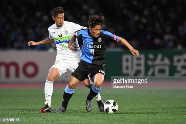 Yoshito Okubo of Kawasaki Frontale and Hiroki Akino of Shonan Bellmare compete for the ball during the JLeague J1 match between Kawasaki Frontale and...