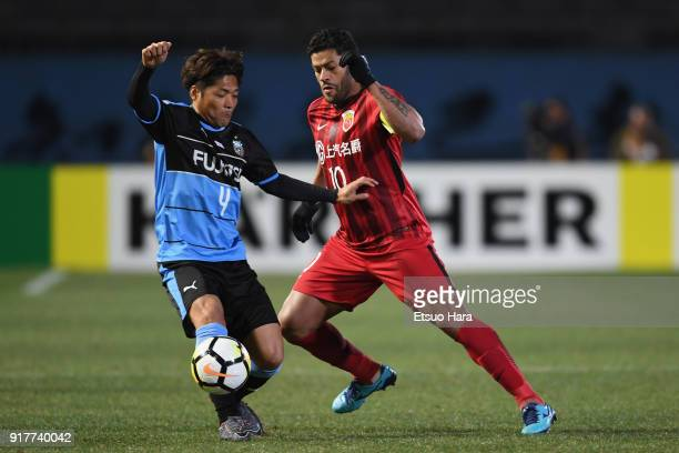 Yoshito Okubo of Kawasaki Frontale and Hulk of Shanghai SIPG compete for the ball during the AFC Champions League Group F match between Kawasaki...