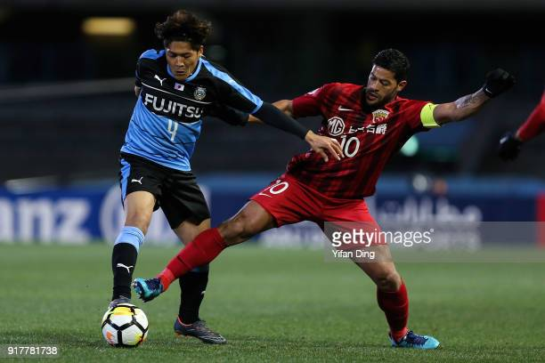 Yoshito Okubo of Kawasaki Frontale and Hulk of Shanghai SIPG fight for the ball during the AFC Champions League Group F match between Kawasaki...