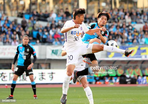 Yoshito Okubo of Kawasaki Frontale and Kosei Shibasaki of Sanfrecce Hiroshima compete for the ball during the JLeague J1 match between Kawasaki...