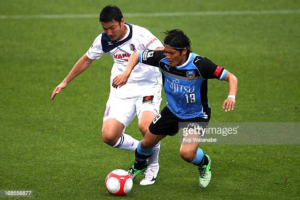 Yoshito Okubo of Kawasaki Frontale and Moniwa Teruyuki compete for the ballduring the J.League match between Kawasaki Frontale and Cerezo Osaka at...
