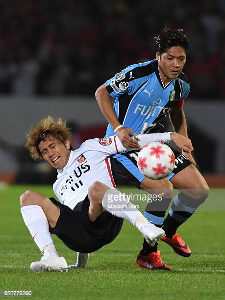 Yoshito Okubo of Kawasaki Frontale and Yosuke Kashiwagi of Urawa Red Diamonds compete for the ball during the 96th Emperor's Cup fourth round match...