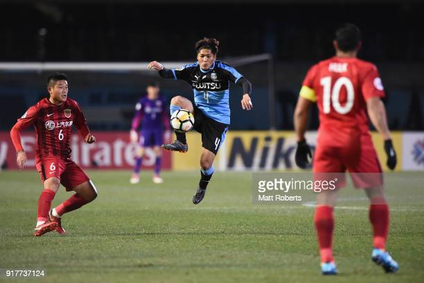 Yoshito Okubo of Kawasaki Frontale controls the ball under pressure of Cai Huikang of Shanghai SIPG during the AFC Champions League Group F match...