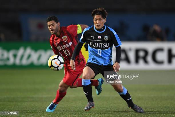 Yoshito Okubo of Kawasaki Frontale controls the ball under pressure of Hulk of Shanghai SIPG during the AFC Champions League Group F match between...