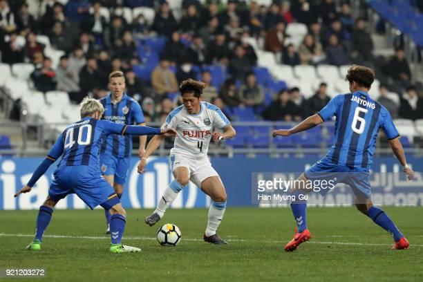 Yoshito Okubo of Kawasaki Frontale controls the ball under pressure of Ulsan Hyundai defense during the AFC Champions League Group F match between...
