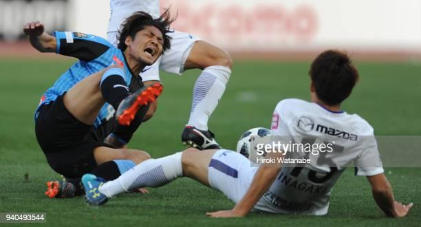 Yoshito Okubo of Kawasaki Frontale is challenged during the JLeague J1 match between Kawasaki Frontale and Sanfrecce Hiroshima at Todoroki Stadium on...