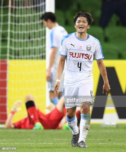 Yoshito Okubo of Kawasaki Frontale reacts after Kosta Barbarouses of Melbourne Victory scores the only goal in the 90th minute of a group stage match...