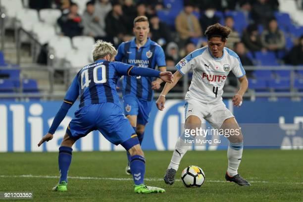 Yoshito Okubo of Kawasaki Frontale takes on Richard Windbichler of Ulsan Hyndai during the AFC Champions League Group F match between Ulsan Hyundai...