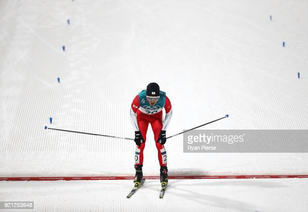 Yoshito Watabe of Japan reacts after crossing the finish line during the Nordic Combined Individual Gundersen 10km CrossCountry on day eleven of the...