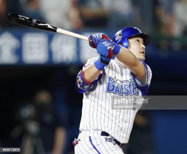 Yoshitomo Tsutsugo hits a tworun home run in the sixth inning of the DeNA BayStars' 62 win over the Hanshin Tigers at Yokohama Stadium on Sept 29...