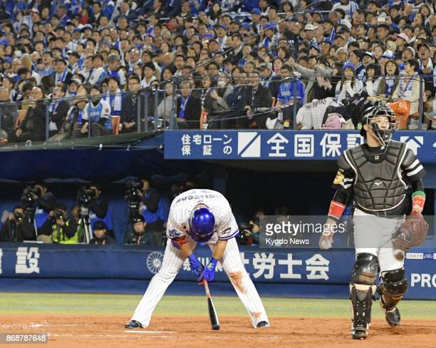 Yoshitomo Tsutsugo of the DeNA BayStars reacts after being called out on strikes in the seventh inning against the SoftBank Hawks in Game 3 of the...