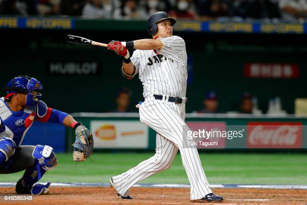 Yoshitomo Tsutsugoh of Team Japan hits a tworun Home run in seventh inning during the Game 1 of Pool B against Team Cuba at the Tokyo Dome on Tuesday...