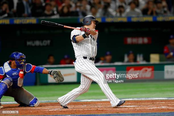 Yoshitomo Tsutsugoh of Team Japan hits an RBI single in the third inning during Game 4 of Pool E of the 2017 World Baseball Classic against Team Cuba...