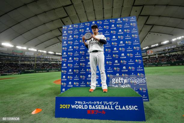Yoshitomo Tsutsugoh of Team Japan poses with Group B MVP trophy after Game 6 of Pool B of the 2017 World Baseball Classic against Team China at the...