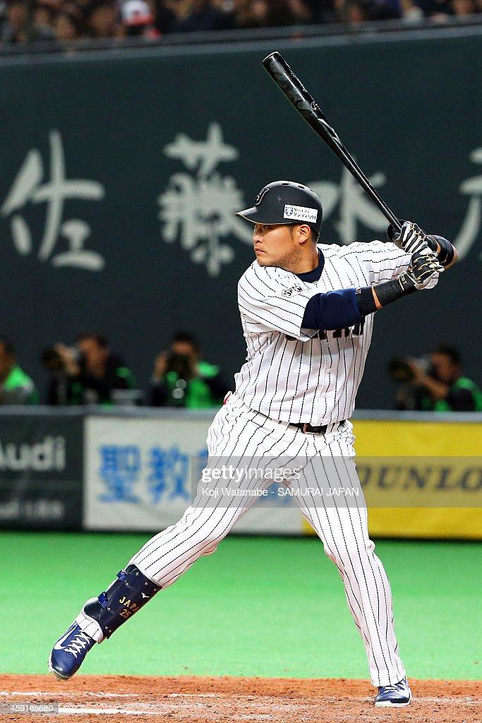 Yoshitomo Tsutsugou #25 bats during the game five of Samurai Japan and MLB All Stars at Sapporo Dome on November 18, 2014 in Sapporo, Hokkaido, Japan.