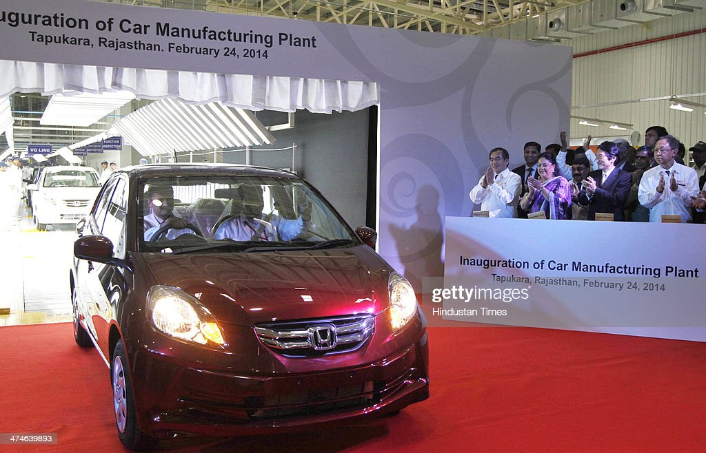 Yoshiyki Matsumoto Mangaing Officer of Honda Motors Co, Japan, Rajasthan Chief Minister Vasundhara Raje Scindia, Yasuhisa Kawamura Deputy Chief of Mission Japan Embassy, Hironori Kanayama President and CEO of Honda Cars India, during the Honda first car roll out and inauguration of Honda Cars Manufacturing plant on February 24, 2014 in Alwar, India. The Rs 3,520-crore plant, which has a total production capacity of 1.2 lakh cars per annum, effectively doubles the companys total manufacturing capacity to 2.4 lakh cars per annum.
