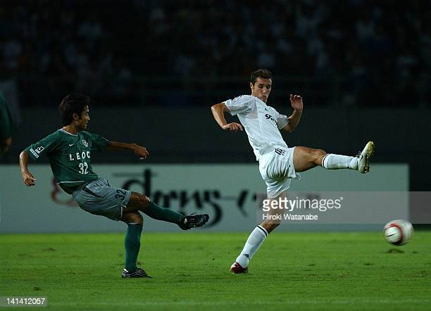 Yoshiyuki Kobayashi of Tokyo Verdy 1969 and Ivan Helguera of Real Madrid compete for the ball during the pre-season friendly match between Tokyo...