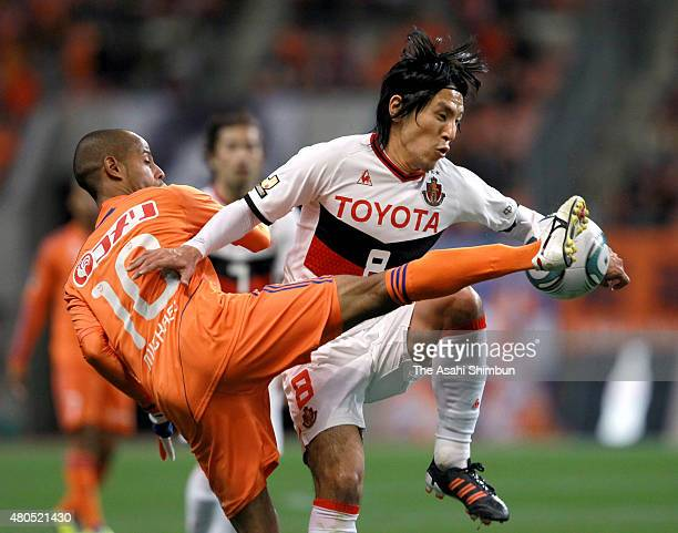Yoshizumi Ogawa of Nagoya Grampus and Michael of Albirex Niigata compete for the ball during the JLeague match between Albirex Niigata and Nagoya...