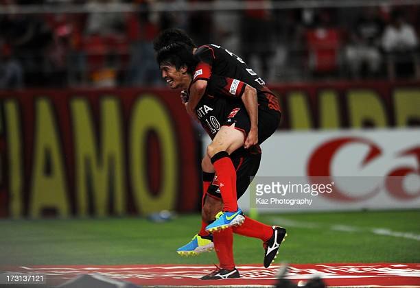 Yoshizumi Ogawa of Nagoya Grampus celebrates scoring his team's second goal with his team mate Hayuma Tanaka during the J.League match between Nagoya...