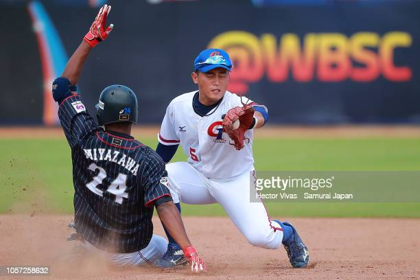Yoshua Miyazawa of Japan slides safely into second base against Cheng-En Li of Chinese Taipei in the 7th inning during the WBSC U-23 World Cup Group...