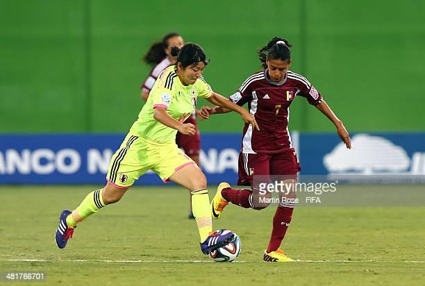 Yosneidy Zambrano of Venezuela and Yu Endo of Japan battle for the ball during the FIFA U17 Women's World Cup 2014 semi final match between Venezuela...