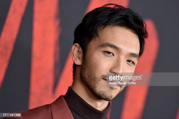 Yoson An attends the premiere of Disney's Mulan on March 09 2020 in Hollywood California