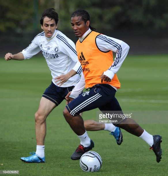 Yossi Benayoun and Florent Malouda of Chelsea in action during a training session ahead of their third round Carling Cup match against Newcastle...