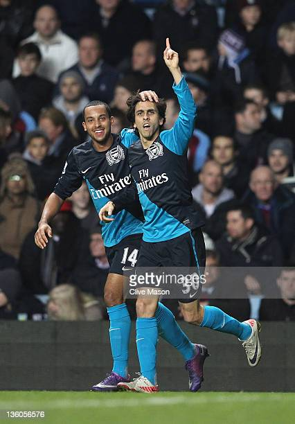 Yossi Benayoun of Arsenal celebrates his goal with team mate Theo Walcott during the Barclays Premier League match between Aston Villa and Arsenal at...