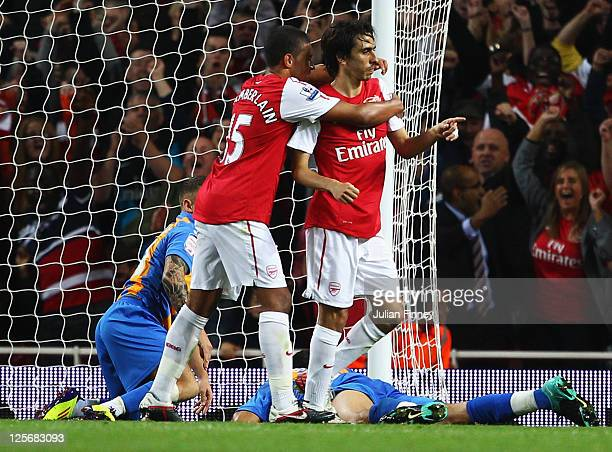 Yossi Benayoun of Arsenal celebrates with Alex OxladeChamberlain as he scores their third goal during the Carling Cup Third Round match between...