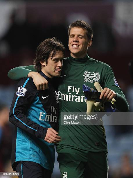 Yossi Benayoun of Arsenal celebrates with team mate Wojciech Szczesny during the Barclays Premier League match between Aston Villa and Arsenal at...