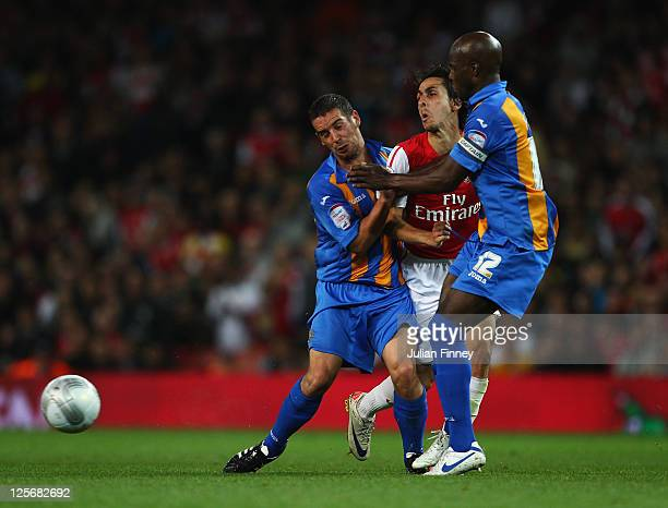 Yossi Benayoun of Arsenal is blocked by Sean McAllister and Reuben Hazell of Shrewsbury Town during the Carling Cup Third Round match between Arsenal...