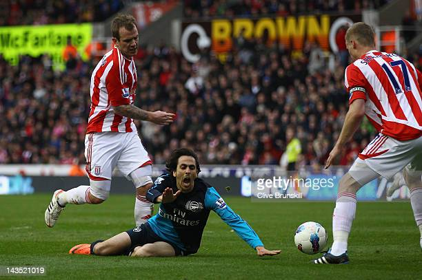 Yossi Benayoun of Arsenal is brought down by Glenn Whelan of Stoke City in the penalty box in the second half during the Barclays Premier League...