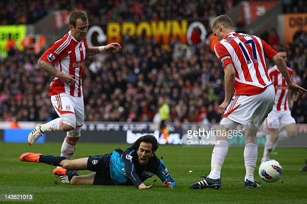 Yossi Benayoun of Arsenal is brought down in the penalty box in the second half during the Barclays Premier League match between Stoke City and...