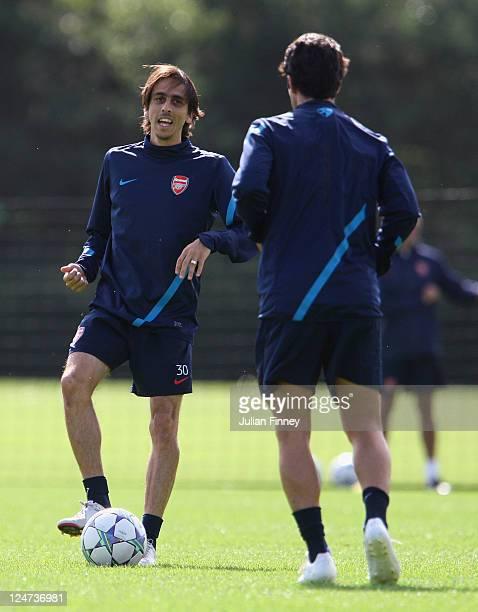 Yossi Benayoun of Arsenal passes the ball during a training session ahead of their UEFA Champions League Group match against Borussia Dortmund at...