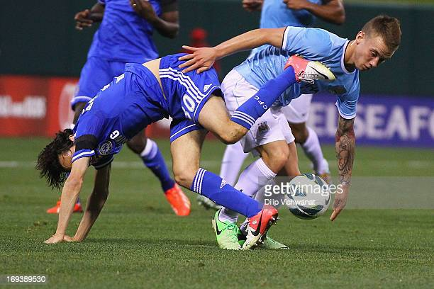 Yossi Benayoun of Chelsea trips over Albert Rusnak of Manchester City of Manchester City while going for the ball during a friendly match at Busch...