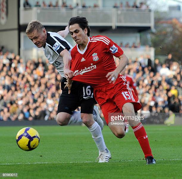 Yossi Benayoun of Liverpool competesfor the ball with Damien Duff of Fulham during the Barclays Premier League match between Fulham and Liverpool at...