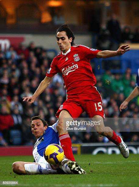 Yossi Benayoun of Liverpool is stopped in the goal mouth by Stephen Warnock of Blackburn Rovers during the Barclays Premier League match between...