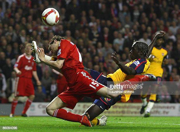 Yossi Benayoun of Liverpool tangles with Bacary Sagna of Arsenal prior to scoring his team's second goal during the Barclays Premier League match...