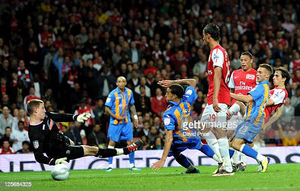 Yossi Benayoun scores Arsenal's 3rd goal past Ben Smith of Shrewsbury during the Carling Cup Third Round match between Arsenal and Shrewsbury Town at...