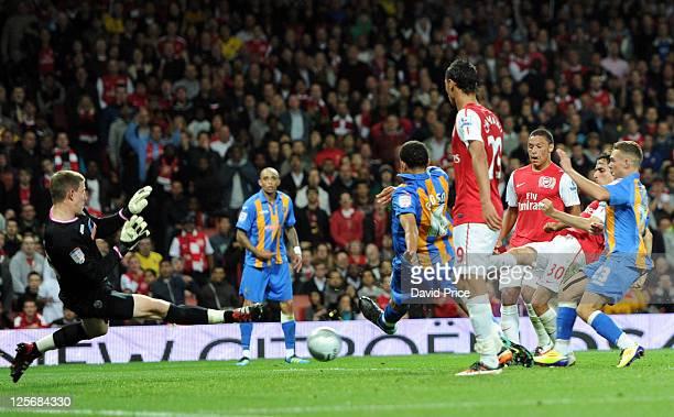 Yossi Benayoun scores Arsenal's third goal past Ben Smith of Shrewsbury during the Carling Cup Third Round match between Arsenal and Shrewsbury Town...