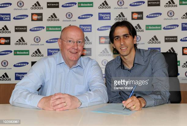Yossi Benayoun Signs for Chelsea with David Barnard Director / Club Secretary at Chelsea FC Training Ground on July 2 2010 in Cobham England